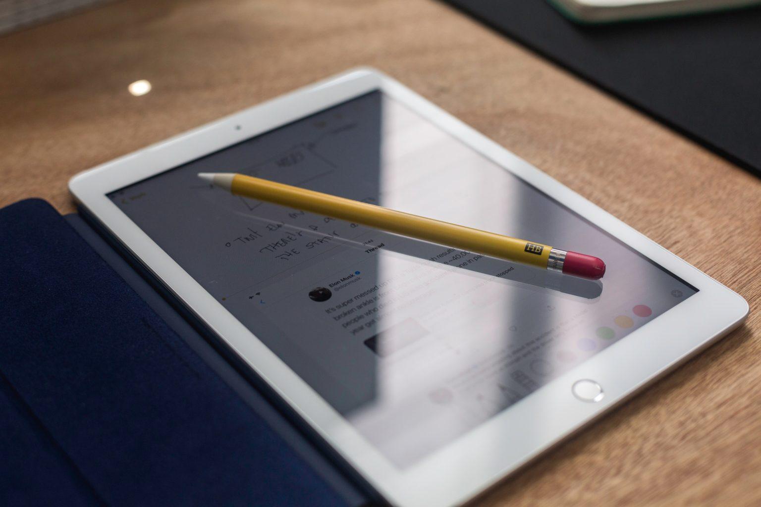 yellow pencil on white iPad